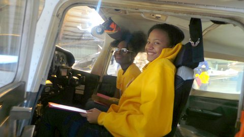 Grace chapter teenshop members inside the aircraft